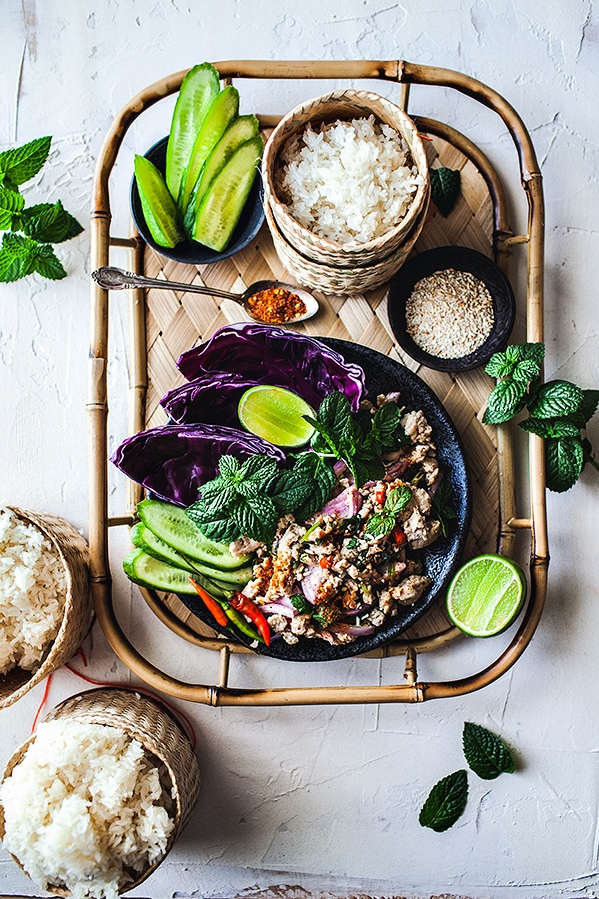 A healthy and easy Thai chicken salad recipe with fresh flavors. This low carb, gluten free and Keto friendly dish offers a fresh, lightly spicy and tangy flavor. And top it off with a slight crunchy and earthy texture from the toasted rice.