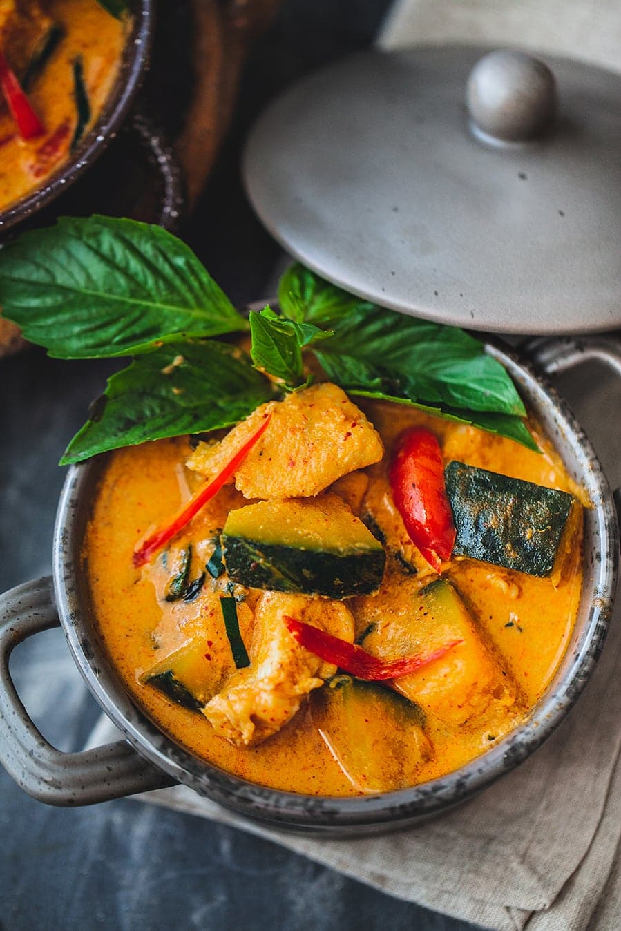 This red Thai curry with chicken and Kabocha squash recipe is an easy and healthy fall dish using Kobucha squash. It is a simple and delicious with a tinge of spiciness from the red curry paste. The extra creamy texture comes from the coconut milk, coconut cream and the Kabocha squash. This easy and healthy Thai curry recipe is just the perfect combination dish for a fall weather.