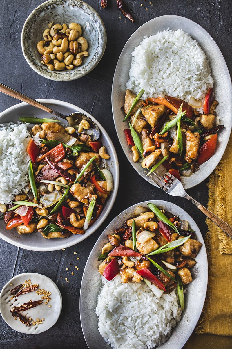 This Easy Cashew Chicken recipe is full of rich flavors with the added vegetables and cashew nuts. Not only is it a quick and easy recipe that you can whip up in 30 minutes or less,but it is also a healthy meal when adding extra vegetables to the dish.#easycashewchicken #thaicashewchicken #cashewchickenstirfry