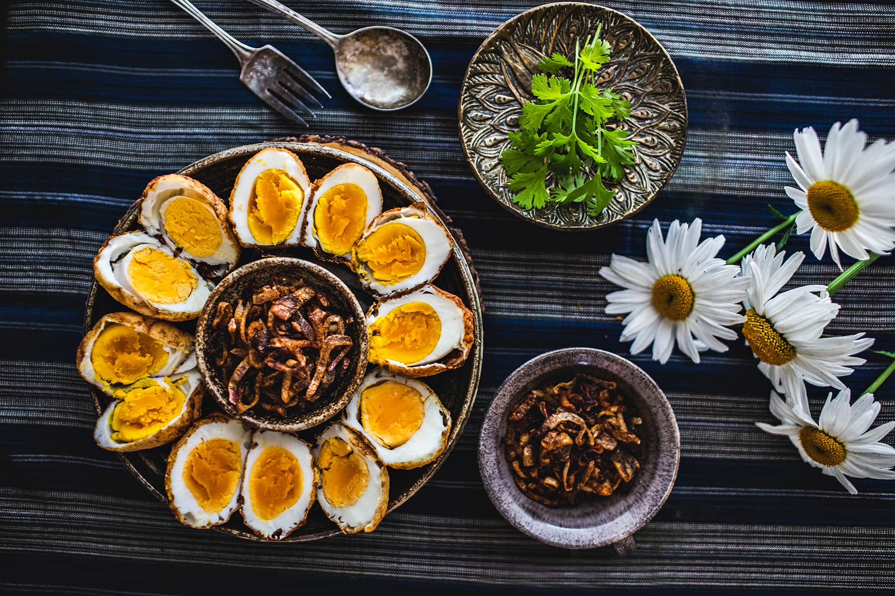 Thai Son-in-LawEggs is a simple recipe that useshard-boiled eggs,deep-fried until the skin is golden brown,then served with a perfectly balanced dressing made from tamarind juice, fish sauce, and palm sugar. #soninlaweggs #easythairecipe #padthaisauce