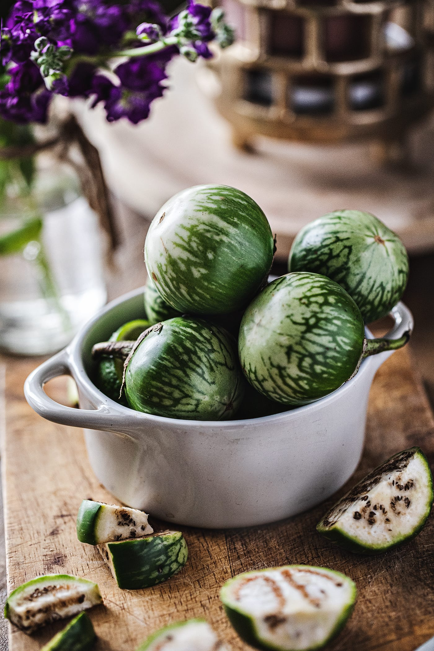 Thai eggplants are from the eggplant family, they have a white interior with tiny soft seeds that look almost like pepper seeds. The taste is crispy and a tiny bit earthly and way less chewy than the long purple eggplants. #thaieggplants #thaifood #eggplants