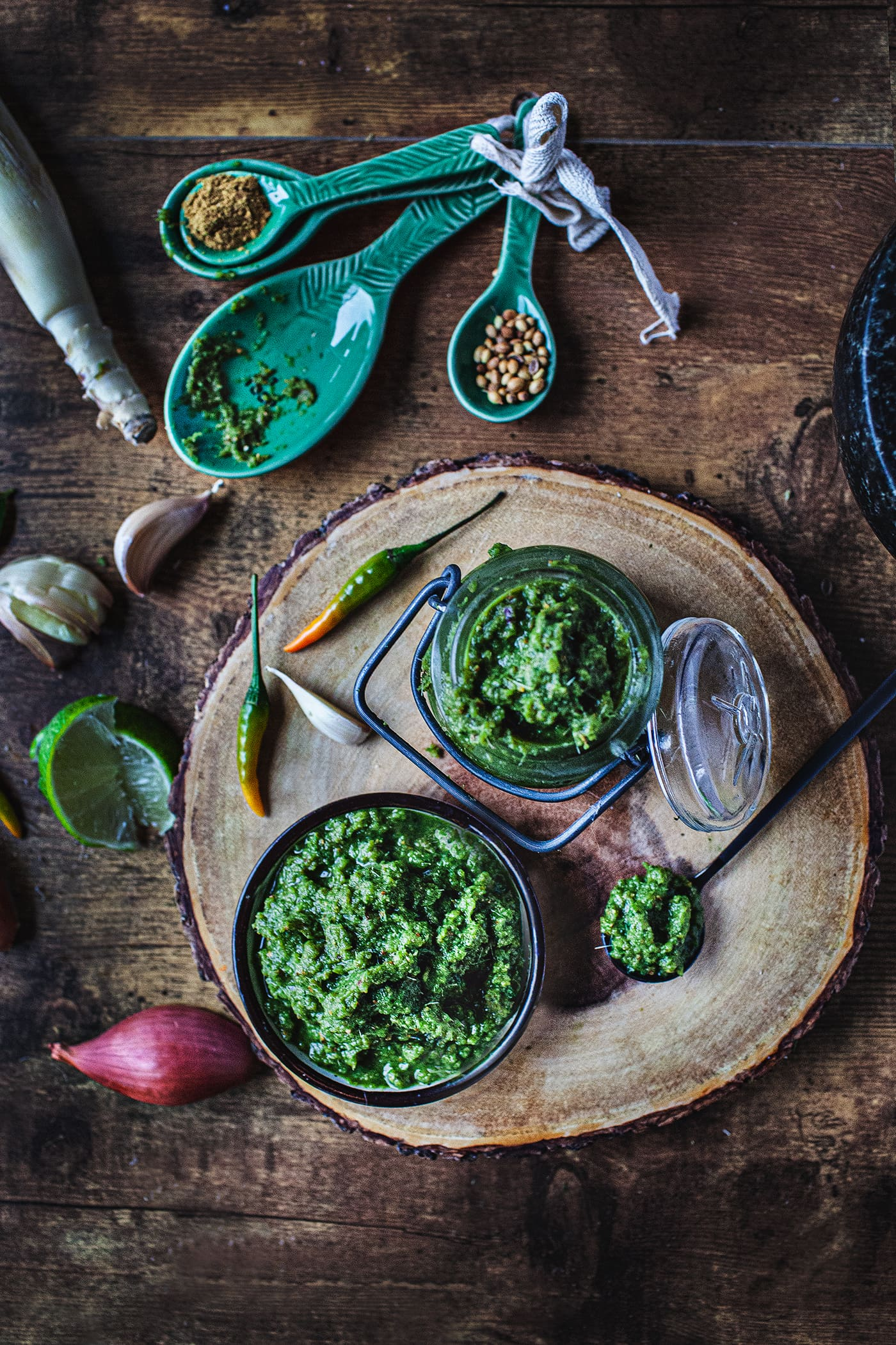 Green curry paste is made from fresh Thai green chilis, garlic, shallots, galangal, kaffir lime rind and leaves, lemongrass, cilantro roots and shrimp paste. These ingredients are typically ground together in a granite mortar and pestle to a paste and that paste is then used to make green curry paste. #greencurrypaste #thaipeppers #thaigreencurry #greencurry