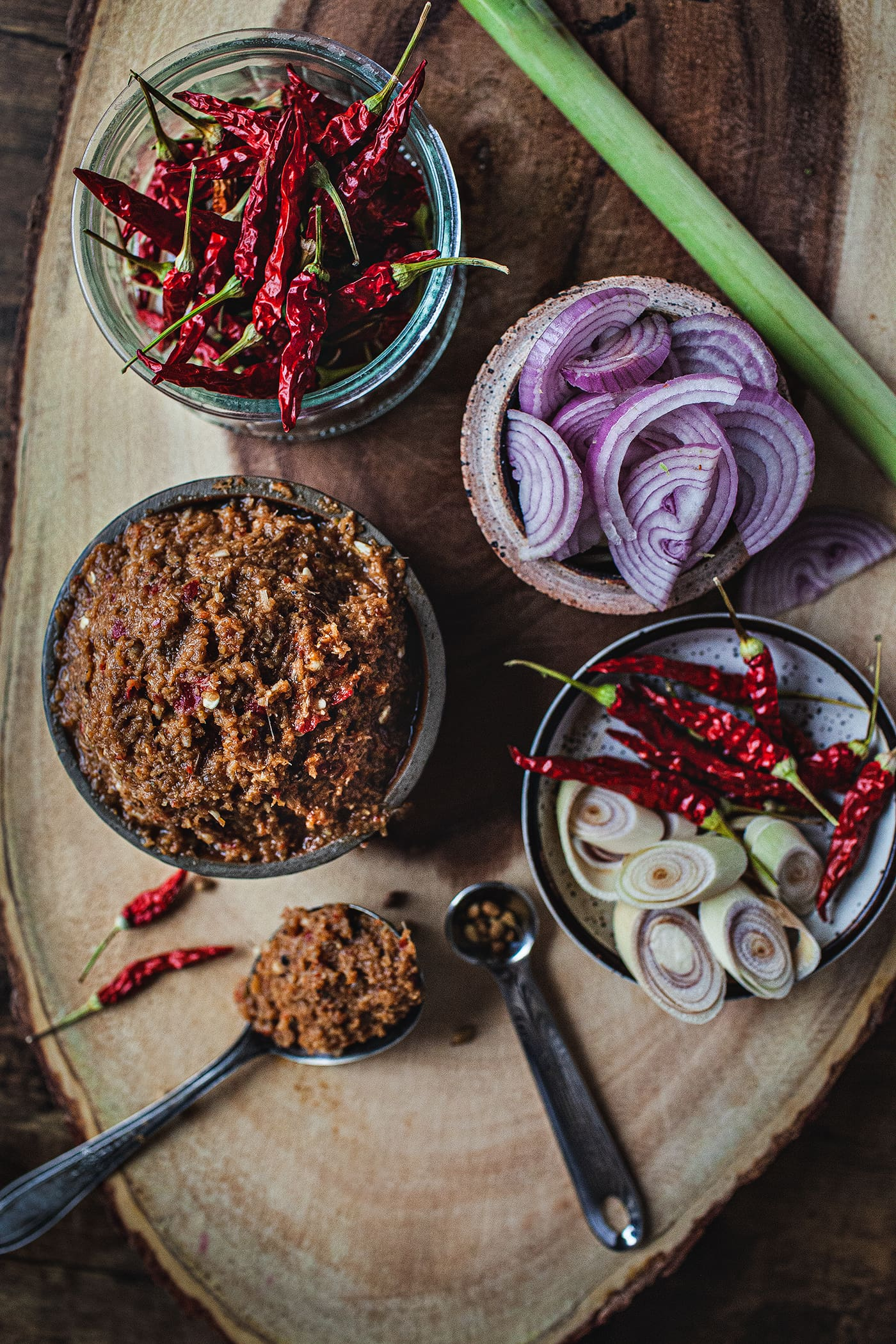 red curry paste is made from dried Thai red chilis, garlic, shallots, galangal, kaffir lime rind and leaves, lemongrass, cilantro roots and shrimp paste. These ingredients are typically ground together in a granite mortar and pestle to a paste and that paste is then used to make green curry paste. #redcurrypaste #thaipeppers #thairedcurry #redcurry