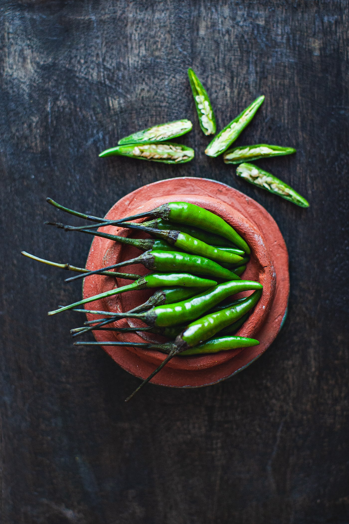 Fresh Thai green bird's eye chilis are used extensively in Thai cuisine to help add the spicy flavors to food. #greenchilis #birdseyechilis #thaipeppers #thaigreenpeppers