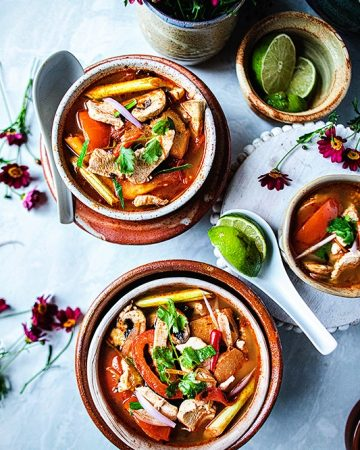 Tom Yum Soup is a popular Thai sour and spicy soup with bold flavors from chicken broth, tom yum soup paste, lemongrass, galangal, kaffir lime leaves, fish sauce and fresh lime juice. Not only is this delicious Tom Yum soup recipe with chicken healthy, it is full of flavors that will keep you wanting more all winter long. #tomyumsoup #tomyumgai #tomyumrecipe #authetictomyumrecipe