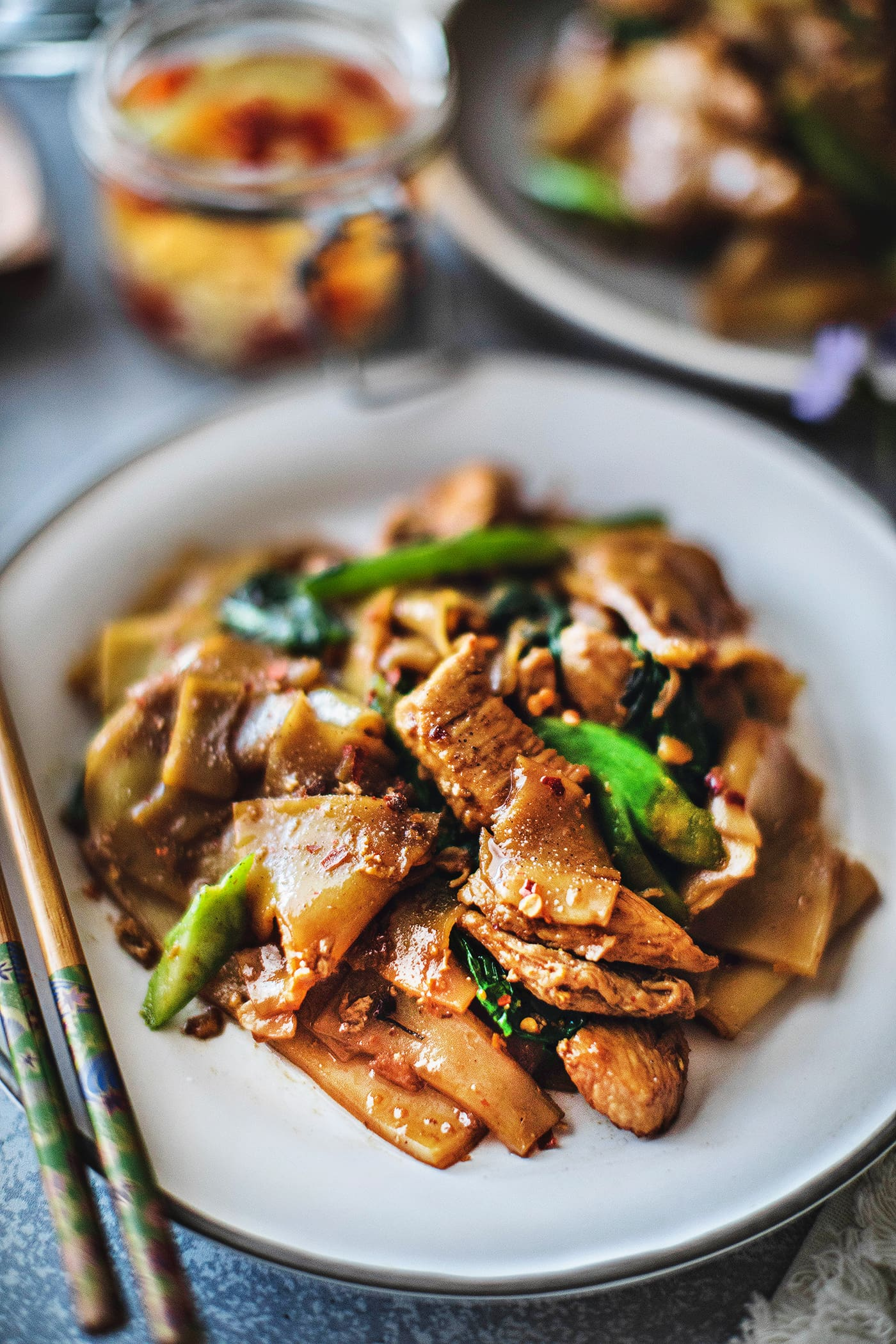 Pad See Ew is one of the most delicious Thai stir fry dishes! It uses wide rice noodles, garlic, eggs, sauces, and Chinese broccoli. This popular street food has a silky and savory flavor from the use of Thai sauces, making this Pad See Ew recipe delightfully memorable. #padseeew #thaifood #padseeewrecipe #senyai