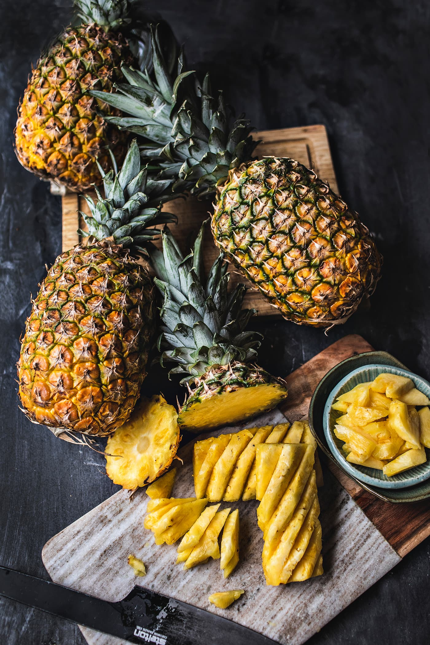 Do you love pineapples but have always been intimidated by how to cut them? Today, I'm going to show you, step by step with helpful photo instructions, how to cut a pineapple, AND how to to make a pineapple bowl! Get ready to be an expert at cutting your favorite fruit.#pineapples #howtocutpineapple #cuttingpineapple #pineapplecutting