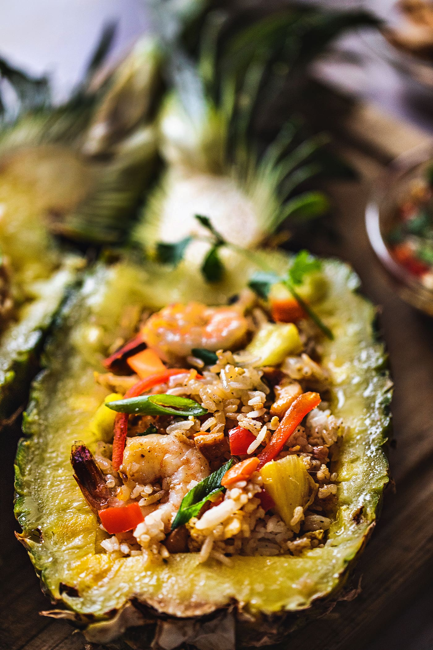 Pineapple fried rice with shrimp is a quick and easy Thai dish that is savory, sweet, and delicious. This recipe is a quick one to put together, taking less than 30 minutes. Perfect for a busy weeknight dinner!#shrimppineapplefriedrice #pineapplefriedrice #thaipineapplefriedrice #thaifriedrice
